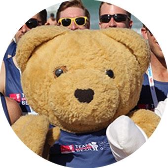 Team Bandaged Bear members with the Bandaged Bear mascot